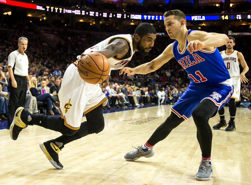 . Cleveland Cavaliers\' Kyrie Irving, left, drives to the basket with Philadelphia 76ers\' Nik Stauskas defending during the first half of an NBA basketball game, Saturday, Nov. 5, 2016, in Philadelphia. (AP Photo/Chris Szagola)