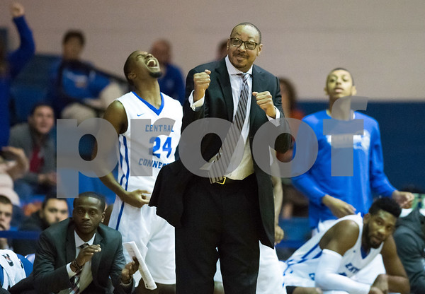 11/30/17 Wesley Bunnell | Staff CCSU Men's Basketball defeated North Carolina A&T on Thursday evening at Derrick Gymnasium in New Britain. Head coach Donyell Marshall reacts after a Blue Devil basket along with Chris Williams (24).
