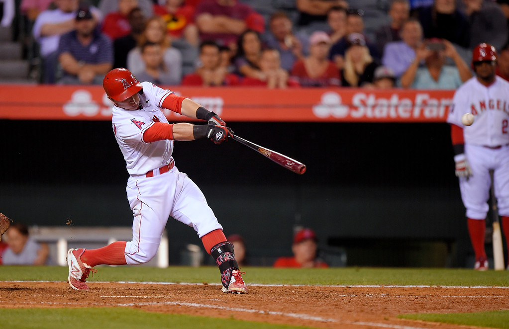 . Los Angeles Angels\' Johnny Giavotella hits a two-RBI single during the eighth inning of a baseball game against the Detroit Tigers, Sunday, May 31, 2015, in Anaheim, Calif. (AP Photo/Mark J. Terrill)