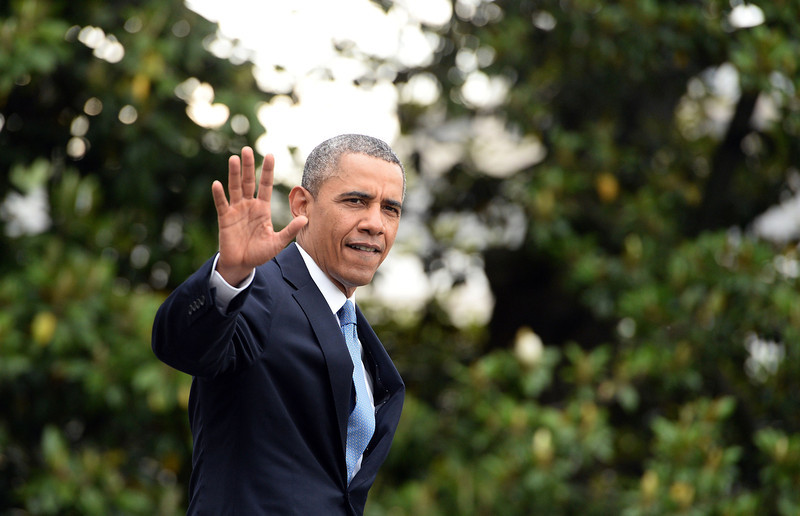 . US President Barack Obama waves as he walks to board Marine One on the South Lawn of the White House in Washington, DC May 28, 2014 to leave for West Point, New York, where he will deliver the commencement address at the US Military Academy. (JEWEL SAMAD/AFP/Getty Images)