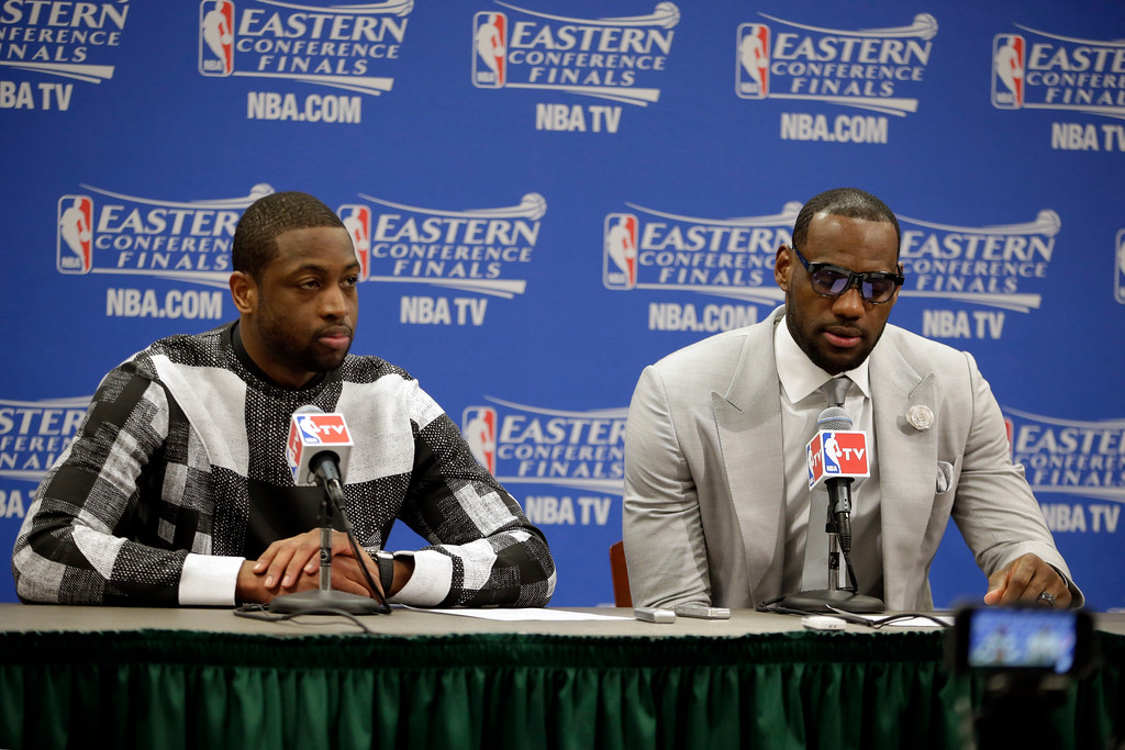 . Miami Heat guard Dwyane Wade and forward LeBron James, right, talk with the media after Game 1 of the Eastern Conference finals NBA basketball playoff series against the Indiana Pacers, Sunday, May 18, 2014, in Indianapolis. The Pacers won 107-96. Wade scored 27 points and James had 25 for the two-time defending NBA champions, who lost for only the second time in 10 playoff games. (AP Photo/AJ Mast)