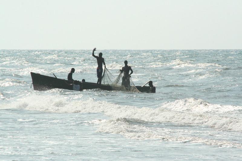 Garífuna youth haul in a fishing net