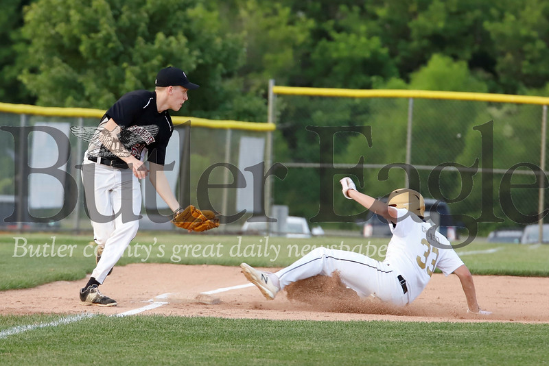 Butler's Josh Grigoletti slides into third beating the throw to Cranberry third baseman Danny Jelinek. Seb Foltz/Butler Eagle