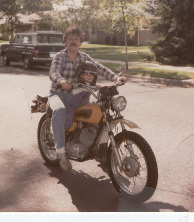 Rick_giving_Andi_her_1st_ride_on_a_motorcyle.jpg