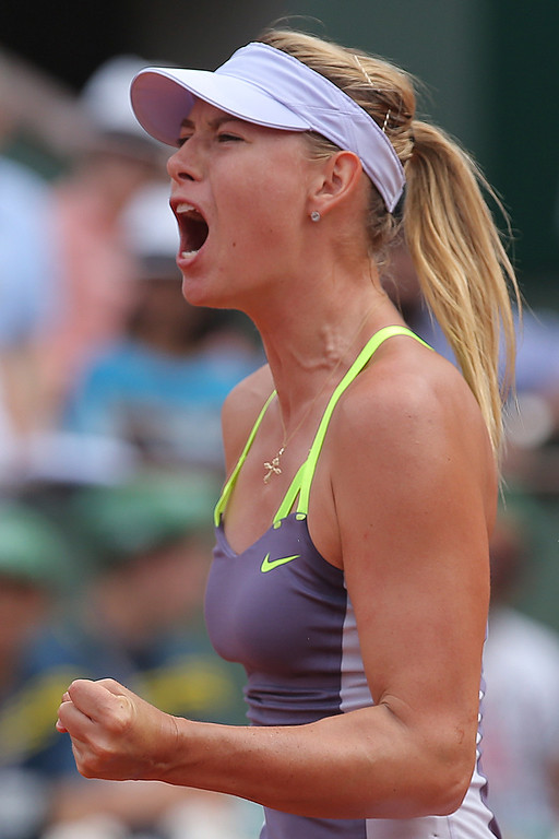 . Russia\'s Maria Sharapova celebrates scoring against Serena Williams of the U.S. in the women\'s final of the French Open tennis tournament, at Roland Garros stadium in Paris, Saturday June 8, 2013. (AP Photo/Michel Euler)