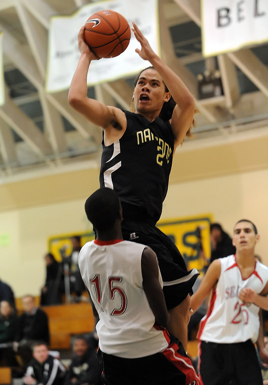 . Narbonne\'s Shailo Leafa (24) goes up and over Palos Verdes\' Sammy Kalejaiye (15) in a pool-play basketball game of the Mira Costa Pacific Shores Tournament Wednesday. Narbonne won the tight game 60-57. December 01, 2010.  Photo by Steve McCrank/Daily Breeze