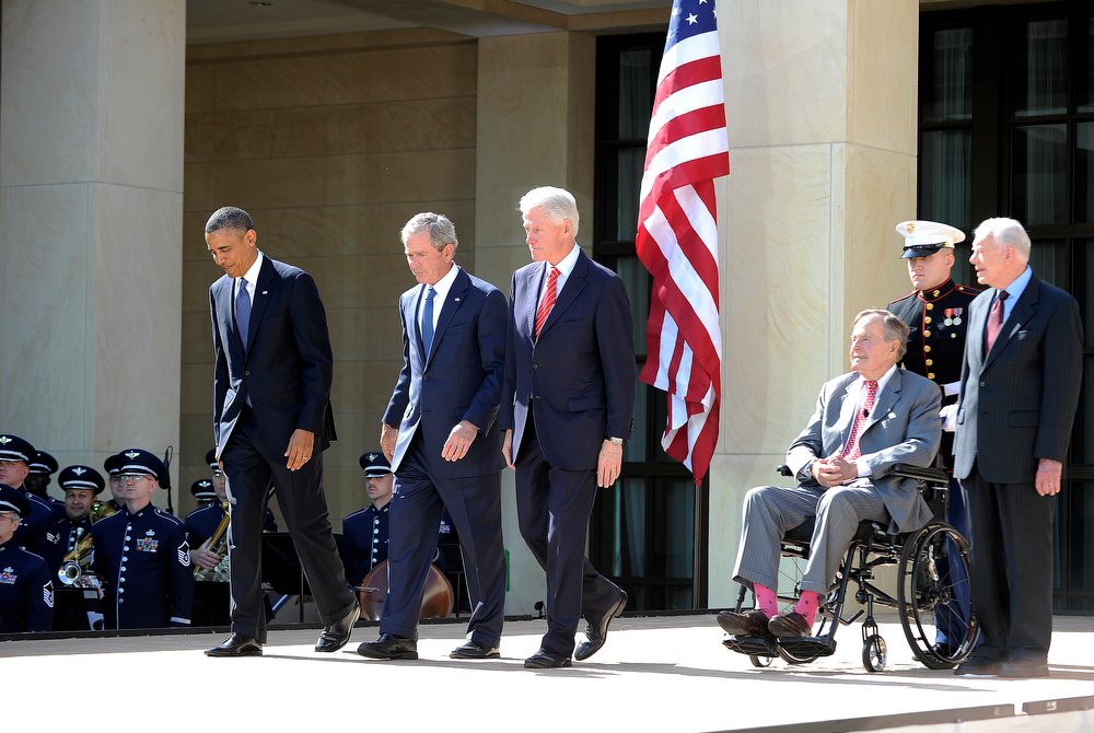 Description of . US President Barack Obama (L) and former US Presidents (L-R) George W. Bush, Bill Clinton, George H.W. Bush and Jimmy Carter arrive on stage for the George W. Bush Presidential Center dedication ceremony in Dallas, Texas, on April 25, 2013.  JEWEL SAMAD/AFP/Getty Images
