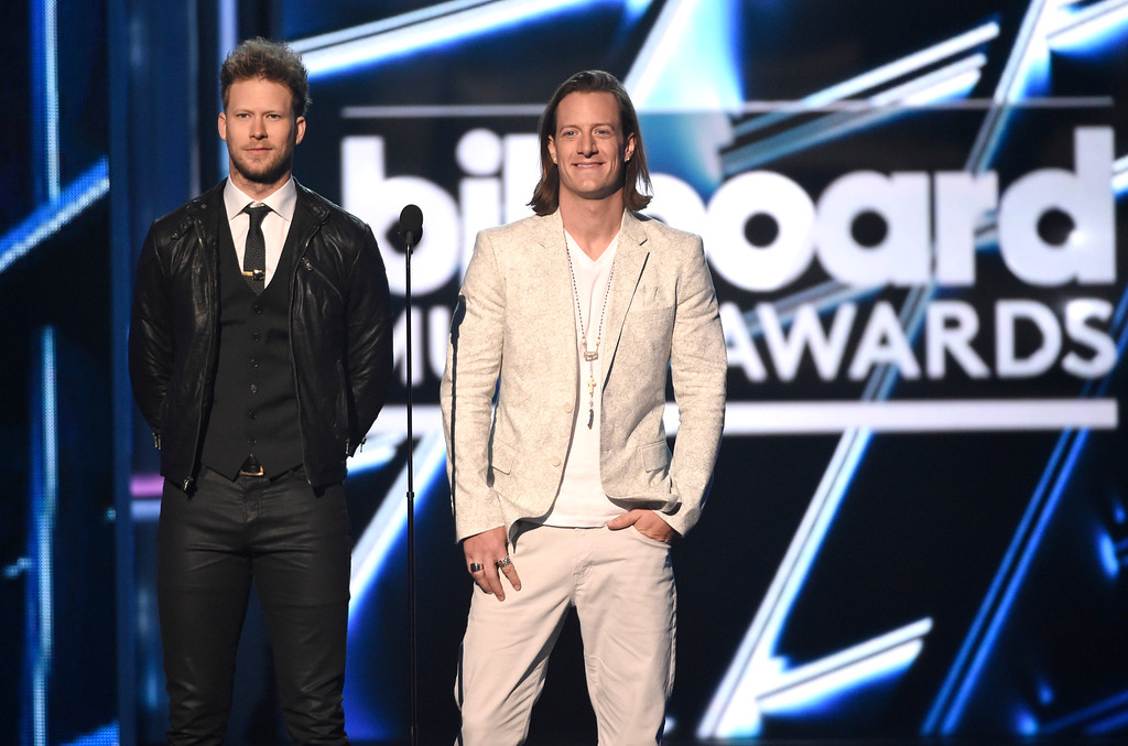 . Brian Kelley, left, and Tyler Hubbard introduce a performance by Little Big Town & Faith Hill at the Billboard Music Awards at the MGM Grand Garden Arena on Sunday, May 17, 2015, in Las Vegas. (Photo by Chris Pizzello/Invision/AP)