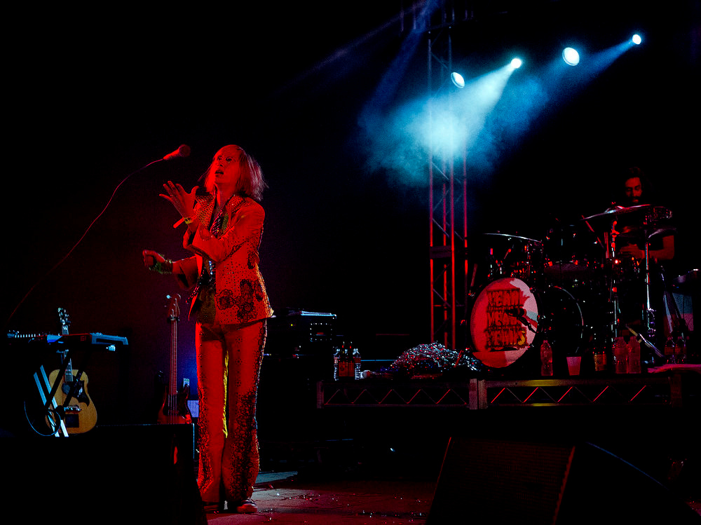 . In this photo taken Wednesday, March 13, 2013, the Yeah Yeah Yeahs perform during the NPR music showcase at Stubb\'s during SXSW 2013 in Austin, Texas. (AP Photo/Austin American-Statesman, Laura Skelding)