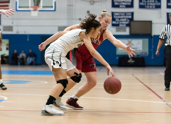 02/21/19 Wesley Bunnell | Staff Newington girls basketball vs E.O. Smith in the CCC Conference Championship game played at Glastonbury High School. Sabrina Soler (1) attempts to regain control of the ball.