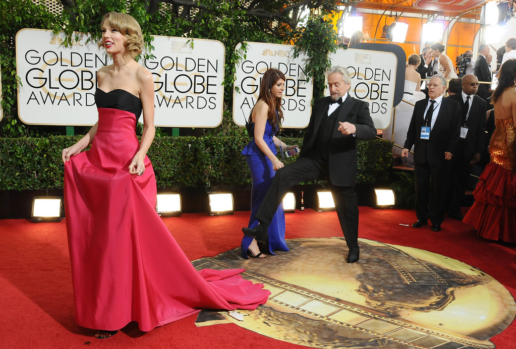 . Taylor Swift, left, and Michael Douglas arrive at the 71st annual Golden Globe Awards at the Beverly Hilton Hotel on Sunday, Jan. 12, 2014, in Beverly Hills, Calif. (Photo by Jordan Strauss/Invision/AP)