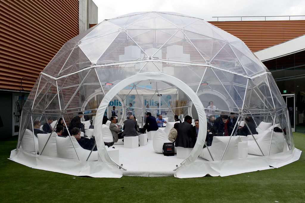 . People sit inside a meeting point at the Mobile World Congress in Barcelona, on February 24, 2014.  The Mobile World Congress runs from the 24 to 27 February where participants and visitors alike can attend conferences, network, discover cutting-edge products and technologies at among the 1,700 exhibitors as well as seek industry opportunities and make deals.   PAU BARRENA/AFP/Getty Images