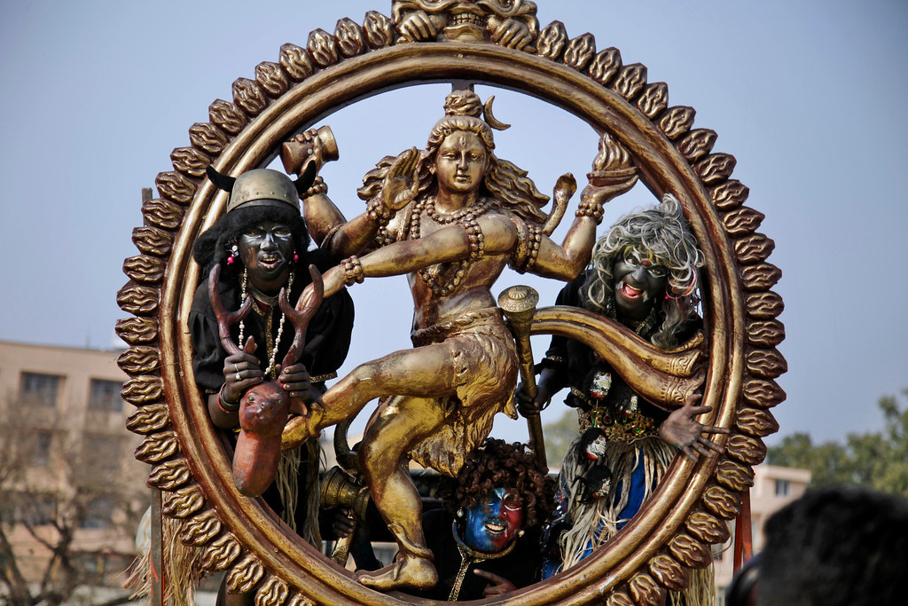 . Hindu devotees dressed as demons participate in a procession on the eve of Shivratri festival, in Jammu, India, Wednesday, Feb. 26, 2014. (AP Photo/Channi Anand)