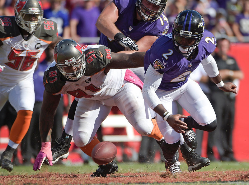 . Baltimore Ravens quarterback Tyrod Taylor (2) fumbles the ball as Tampa Bay Buccaneers defensive end Da\'Quan Bowers (91) recovers the ball during the second half of an NFL football game in Tampa, Fla., Sunday, Oct. 12, 2014. Baltimore won 28-17. (AP Photo/Phelan M. Ebenhack)