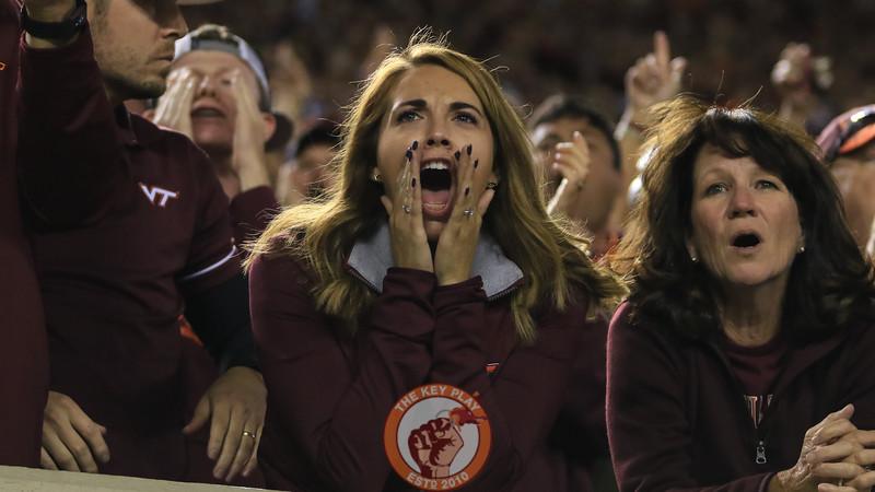 A Virginia Tech fan yells while the Hokies are on defense. (Mark Umansky/TheKeyPlay.com)