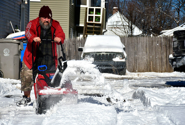 1/30/2019 Mike Orazzi | Staff John Cyr while clearing snow from a driveway on Beech Street in Bristol Wednesday.