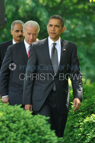 President Obama, Vice President Biden and Attorney General Holder enter the Rose Garden.