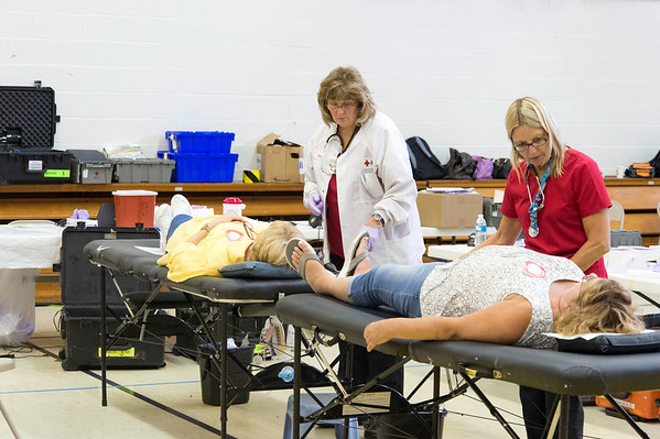 07/01/19 Wesley Bunnell | Staff A blood drive was held on Monday at St. Joseph Church in partnership with the American Red Cross on Monday July 1, 2019. The drive was held in honor of Daniela Ciriello's 7th birthday. Daniella, who suffers from Beta Thalassemia better knows as Cooley's Anemia,, requires a blood transfusion every three weeks. Phlebotomists including Debbie Portalatin, L, assist two donors.