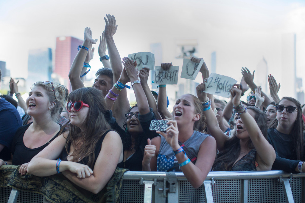 """. Ben Howard fans hold up a sign that says \""""You Brought Us To Lollapalooza\"""" during his performance at the Red Bull Stage at the Lollapalooza Festival in Chicago, Saturday, Aug. 3, 2013. The more than two-decade-old festival opened Friday in Chicago\'s lakefront Grant Park. (AP Photo/Scott Eisen)"""