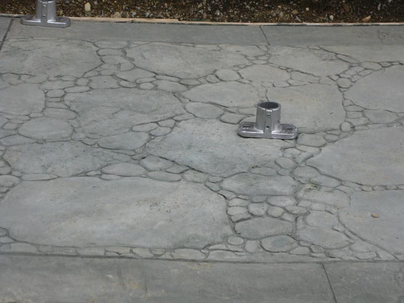 The Wave Blaster queue area floor has this sort of concrete.