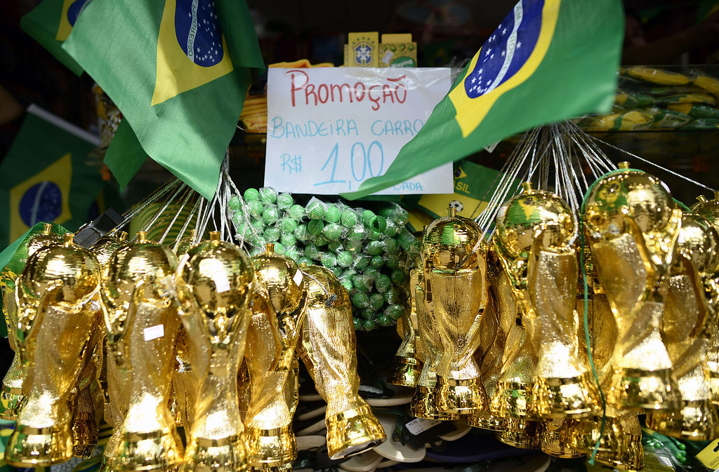 . World Cup merchandise trophies are displayed at a shop in Ribeirao Preto on June 10, 2014, ahead of the 2014 FIFA World Cup in Brazil. AFP PHOTO / FRANCK FIFE/AFP/Getty Images
