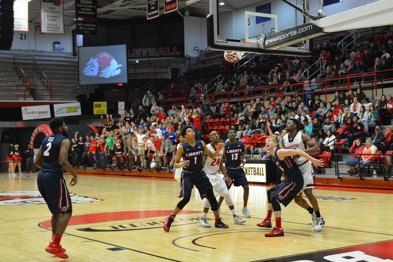 Players watching as Gardner-Webb is scoring.