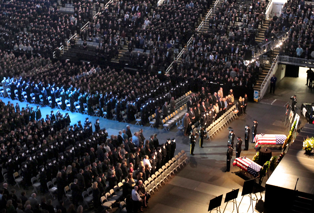 . Thousands of people attend the memorial service for Santa Cruz police detective Elizabeth Butler and Santa Cruz police detective Sgt. Loran \'Butch\' Baker Thursday at HP Pavilion in San Jose. (Shmuel Thaler/Sentinel)
