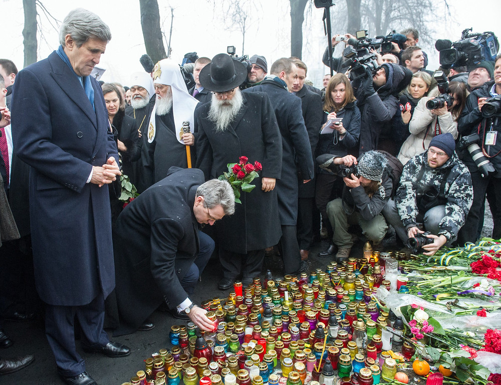 . US Secretary of State John Kerry stands in front of the Shrine of the Fallen, an homage to anti-government protesters who died during the February clashes with anti-riot policemen in Kiev, on March 4, 2014.  AFP PHOTO/ VOLODYMYR SHUVAYEV/AFP/Getty Images