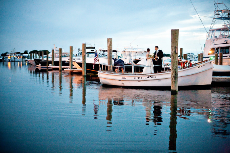 Bride and groom taking wedding photos on the boat launch at Nauticus Marina on Cape Cod. (By Bello Photography) - Nauticus Marina - The Casual Gourmet, Cape Cod Wedding Caterer