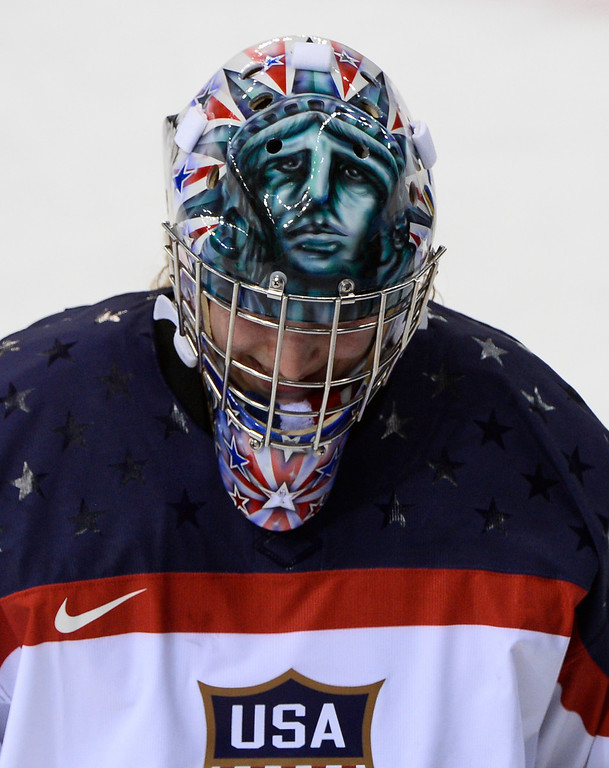 . A drawing depicting the \'\'statue of liberty\'\' is seen on the helmet of US goalkeeper Jessie Vetter as she skates on the ice at timeout during the Women\'s Ice Hockey Group A match between Canada and USA at the Sochi Winter Olympics on February 12, 2014 at the Shayba Arena. AFP PHOTO / JONATHAN NACKSTRAND/AFP/Getty Images