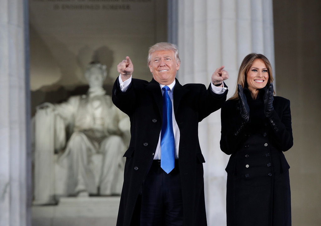 ". President-elect Donald Trump and his wife Melania Trump arrive at a pre-Inaugural ""Make America Great Again! Welcome Celebration\"" at the Lincoln Memorial in Washington, Thursday, Jan. 19, 2017. (AP Photo/Evan Vucci)"