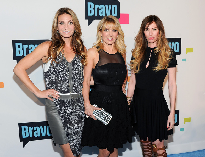 ". ""The Real Housewives of New York City\"" cast members, from left,  Heather Thomson, Ramona Singer and Carole Radziwill attend the Bravo Network 2013 Upfront on Wednesday April 3, 2013 in New York. (Photo by Evan Agostini/Invision/AP)"