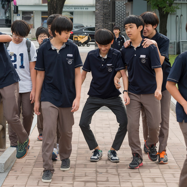 Schoolboys having fun on street, Seoul, South Korea