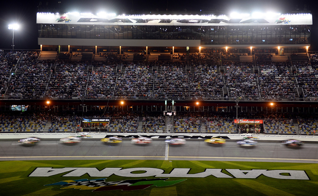 . Cars race during the NASCAR Sprint Cup Series Budweiser Duel 1 at Daytona International Speedway on February 20, 2014 in Daytona Beach, Florida.  (Photo by Jared C. Tilton/Getty Images)