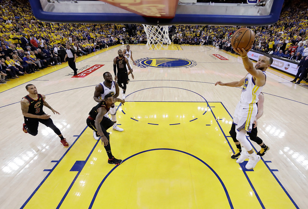 . Golden State Warriors\' Stephen Curry, right, drives to the basket against the Cleveland Cavaliers during the second half of Game 1 of basketball\'s NBA Finals Thursday, May 31, 2018, in Oakland, Calif. (AP Photo/Marcio Jose Sanchez)