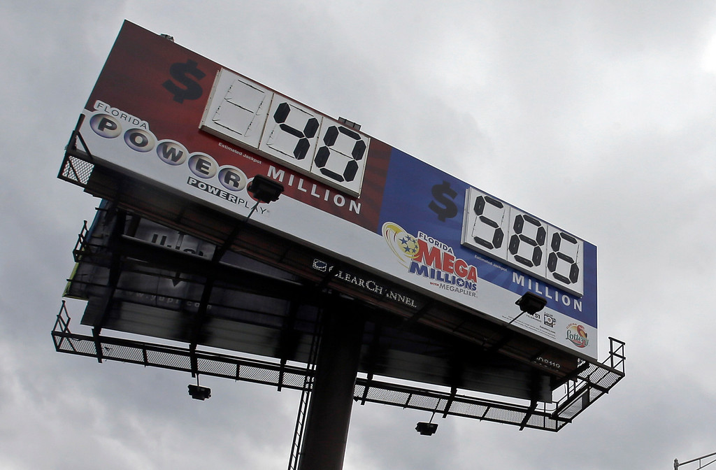 . A billboard shows the jackpot for Powerball and the Mega Millions prize-winning tickets Monday, Dec. 16, 2013, in Hialeah, Fla. The Mega Millions jackpot soared to $586 million on Monday amid a frenzy of ticket purchases, a jump that pushed the prize closer to the $656 million U.S. record set last year. (AP Photo/Alan Diaz)