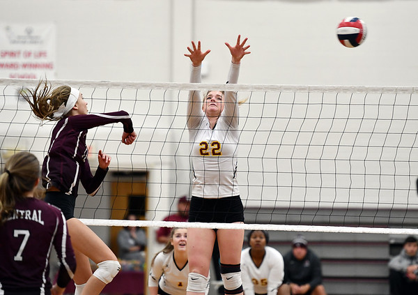 11/14/2019 Mike Orazzi | StaffrBristol Central High School's Emily Ericson (13) and St. Joseph's Lily Mattison (22) during the Class L Second Round Girls Volleyball Tournament at BCHS. r