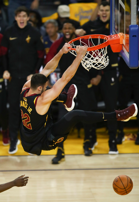 . Cleveland Cavaliers forward Larry Nance Jr. (22) dunks against the Golden State Warriors during the first half of Game 1 of basketball\'s NBA Finals in Oakland, Calif., Thursday, May 31, 2018. (AP Photo/Ben Margot)