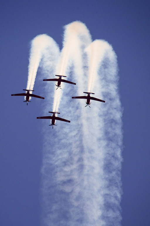 . Efroni T-6 Texan II planes perform in an air show during the graduation ceremony of Israeli air force pilots at the Hatzerim base in the Negev desert, near the southern Israeli city of Beersheva on December 26, 2013. AFP PHOTO / JACK GUEZ/AFP/Getty Images