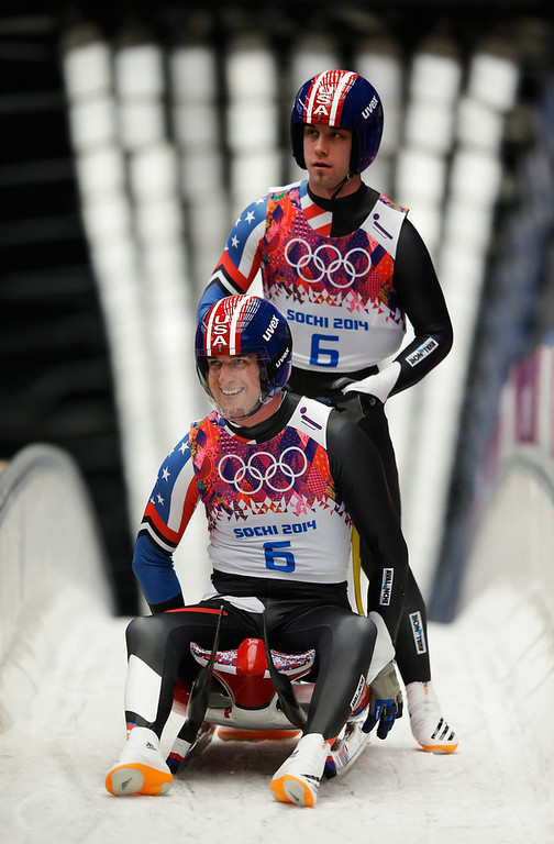 . Christian Niccum (front) and Jayson Terdiman of the United States look on after competing in the Men\'s Luge Doubles on Day 5 of the Sochi 2014 Winter Olympics at Sliding Center Sanki on February 12, 2014 in Sochi, Russia.  (Photo by Ezra Shaw/Getty Images)