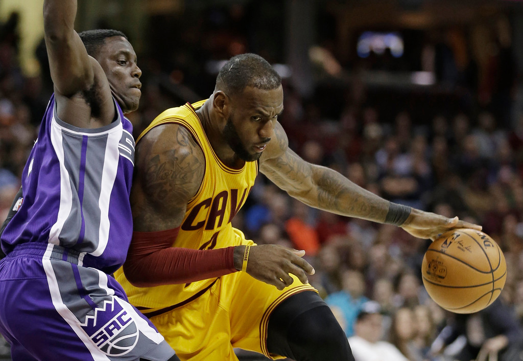 . Cleveland Cavaliers\' LeBron James, right, drives against Sacramento Kings\' Darren Collison during the second half of an NBA basketball game, Wednesday, Jan. 25, 2017, in Cleveland. The Kings won 116-112 in overtime. (AP Photo/Tony Dejak)