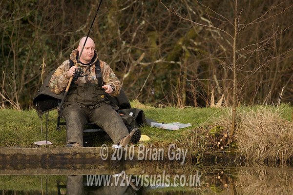 Tony Latter retrieves the empty swimfeeder. © 2010 Brian Gay