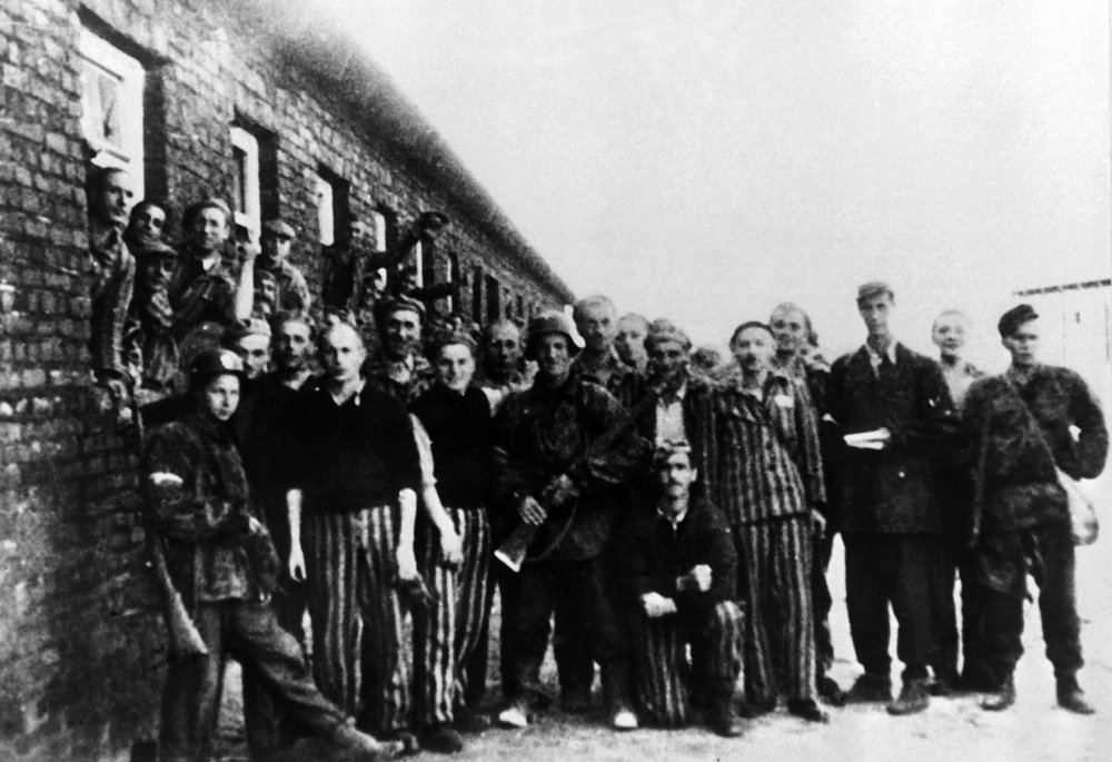 . Prisoners posing with guards outside the prison building in the Warsaw Jewish ghetto during World War II.   AFP/CAF PHOTO