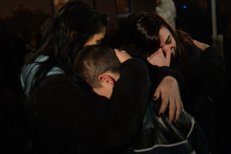 . People gather for a prayer vigil at St Rose Church following an elementary school shooting in Newtown, Connecticut, December 14, 2012.  A young gunman slaughtered 20 small children and six teachers on Friday after walking into a school in an idyllic Connecticut town wielding at least two sophisticated firearms.   EMMANUEL DUNAND/AFP/Getty Images