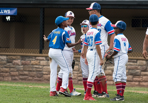 08/06/19 Wesley Bunnell | Staff New Jersey defeated Maryland in a Mid-Atlantic Little League tournament game on Tuesday afternoon at Breen Field in Bristol. Maryland's Aidan Davis (4) talks with Justin Labrador (27), 2nd L, Yady Mateo (28), Jaime Tamayo (20) and Josiah Sharpe (7) after the game.