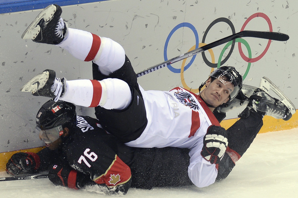 . Canada\'s Pk Subban vies with Austria\'s Oliver Setzinger (top) during the Men\'s Ice Hockey Group B match Canada vs Austria at the Bolshoy Arena during the Sochi Winter Olympics on February 14, 2014.  AFP PHOTO / ALEXANDER NEMENOV/AFP/Getty Images