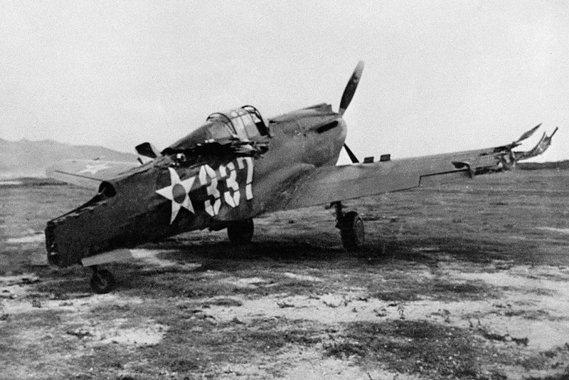 . This is one of the first pictures of the Japanese raid on Pearl Harbor, Dec. 7, 1941. A P-40 plane which was machine-gunned while on the ground. (AP Photo)