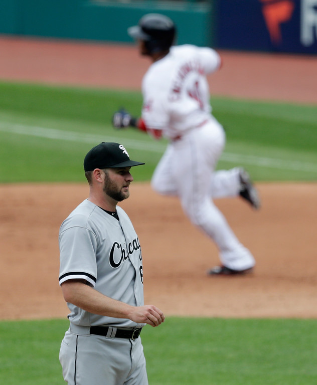 . Chicago White Sox relief pitcher Chris Volstad, left, waits for Cleveland Indians\' Edwin Encarnacion to run the bases after Encarnacion hit a solo home run in the fourth inning of a baseball game, Wednesday, May 30, 2018, in Cleveland. (AP Photo/Tony Dejak)