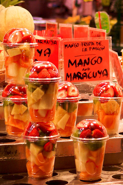 An array of fresh chopped fruit for sale in la Boqueria market in Barcelona, Spain.