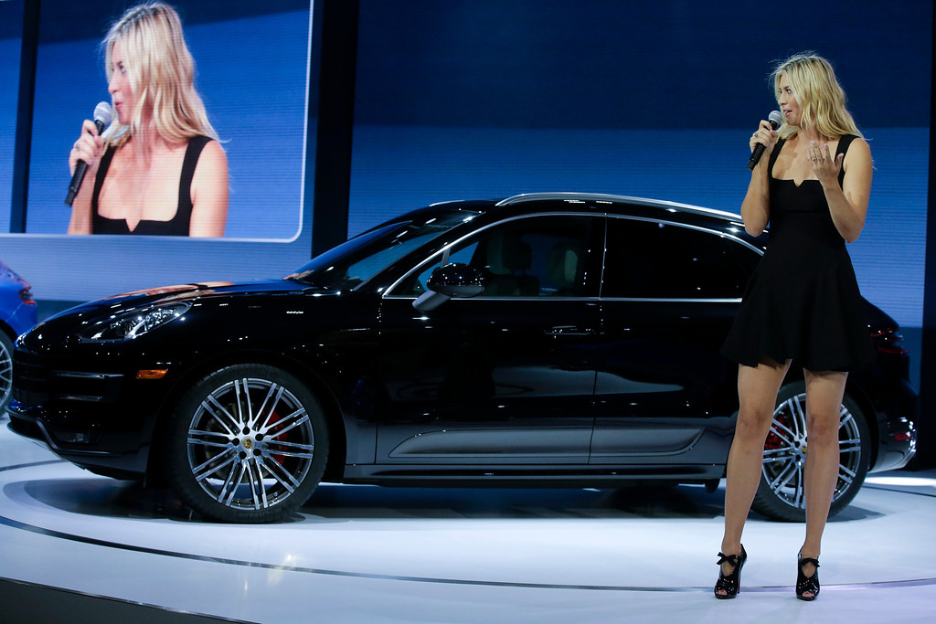 . Tennis player Maria Sharapova talks about the new Porsche Macan Turbo at the Los Angeles Auto Show in Los Angeles, Tuesday, Nov. 19, 2013. (AP Photo/Chris Carlson)